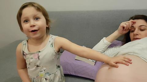 Little Girl Reacts to Baby Moving in Pregnant Mommy's Tummy