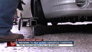 Crews battle changing conditions to clear roads - Video