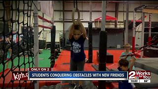 Ninjas-in-training conquering obstacles with new friends
