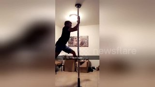 Man tries out pole dancing for the first time but ends up on the floor