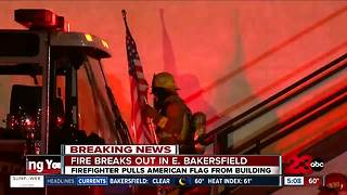 Firefighter fights fire in East Bakersfield and salvages American Flag - Video