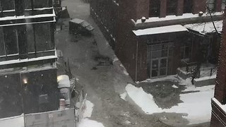 Dumpsters Float Down Boston Street During Nor'easter