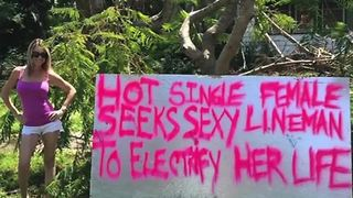 Woman makes sign to get power back on
