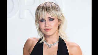 Miley Cyrus didn't spend much time crying over divorce