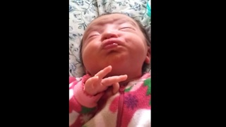 Newborn baby makes adorable facial expressions - Video