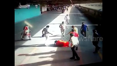 Hero cop saves woman from getting crushed under train