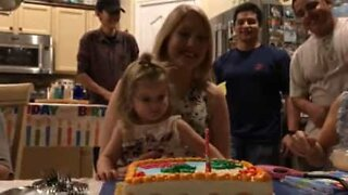 Little girl is in a hurry to eat birthday cake