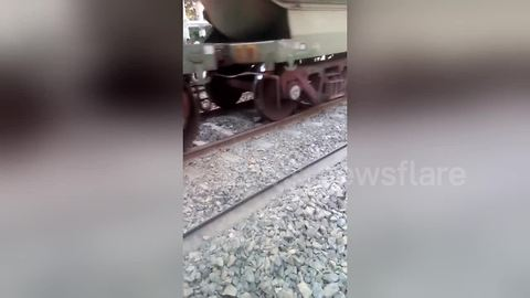 Man escapes miraculously after train runs over him