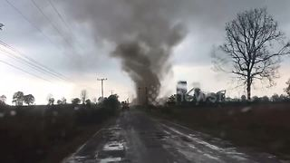 Tornado engulfs car during tropical storm in Thailand - Video
