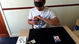 Guy solves Rubik's cube blindfolded using magic - Video