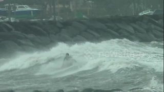 Rare winter storm lashes Hawaii as 60-foot waves anticipated