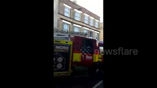 Commuters wait outside Parsons Green station - Video