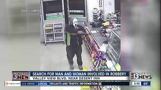 Police looking for couple after store robbed - Video