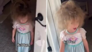 Little girl dressed as a princess wakes up with crazy hair