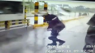 Extreme winds nearly knock toll-gate workers off their feet - Video