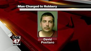 Lansing man charged after unarmed robbery - Video