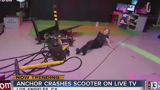 TV anchor crashes scooter on live TV - Video