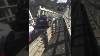 Two Cars Get Into a Standoff on Bridge - Video