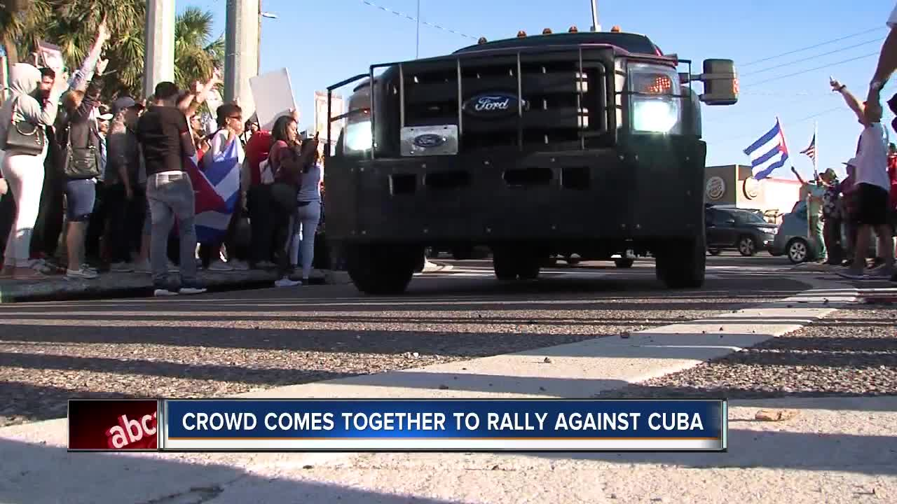 Crowd comes together to rally against Cuba