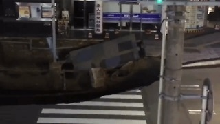 Huge Sinkhole Swallows Road and Traffic Light in Hakata
