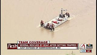 Many people rescued by boat after flooding - Video
