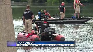 Man missing after jumping off railroad bridge while swimming in Ann Arbor - Video