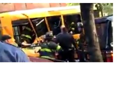 Emergency Personnel Surround School Bus After Ramming Incident in Manhattan - Video