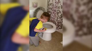Dad Pretends To Be Stuck In The Toilet - Video