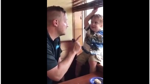 1-year-old humorously argues with his dad