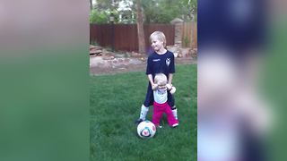 Adorable Tot Girl Learns How To Play Soccer - Video