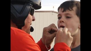 Dad pulls son's baby tooth with a helicopter