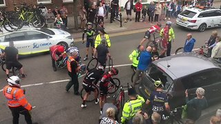 Tour of Britain Cyclist Hopitalized After Crash With Parked Car - Video