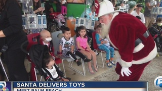 Santa delivers toys to hospitalized children in West Palm Beach - Video