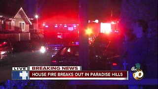 House in Paradise Hills goes up in flames with two people inside