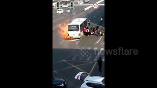 Bus passengers stampede after vehicle bursts into flames - Video