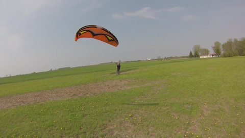 A Paraglider Gets Picked Up By Wind Too Fast