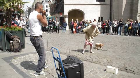 Old Lady Stops In Front Of A Street Performer And Surprises Everyone Watching