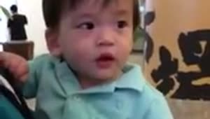 Baby shivers adorably after eating ice cream - Video