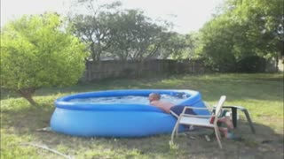 Man Faceplants Into Inflatable Pool - Video