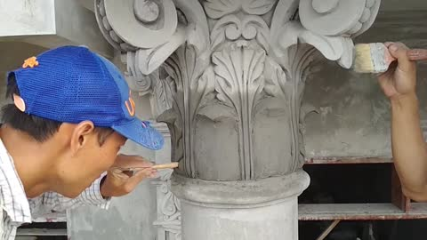 Exquisite Art from sand and cement on concrete columns - Construction News
