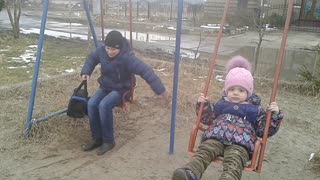 Laughter! See all!!!! Boy stuck in swing.  - Video