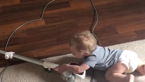 Baby loves to clean