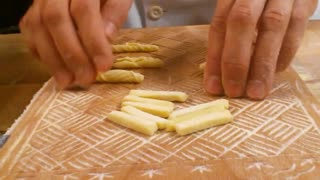 Chef demonstrates how to create designs on pasta - Video