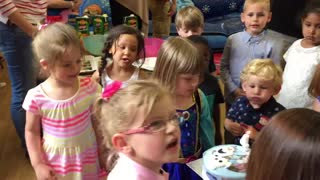 Kid hilariously blows out birthday girl's candle! - Video