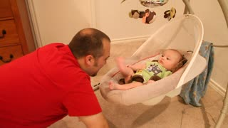 Daddy playing with infant - Video