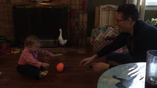 Baby learns how to effectively pass basketball - Video