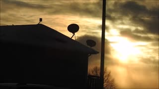Snow Storm Blowing Past and Blocking the Sun  - Video