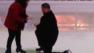 Woman Falls During Proposal on Ice - Video