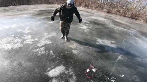 Ice cracks and almost breaks under fisherman