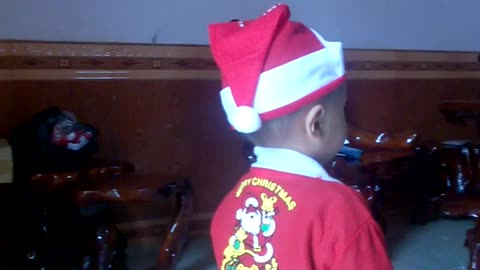 My son dressed in Christmas